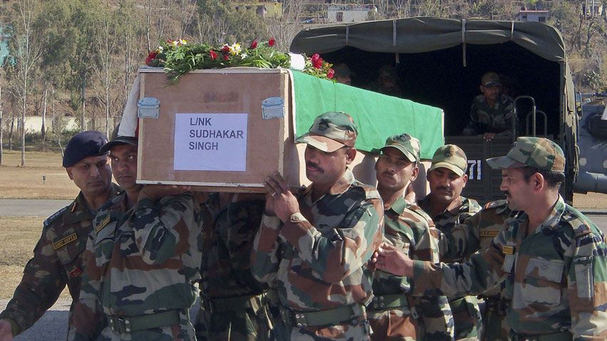 coffin containing the body of a colleague, who was allegedly killed by Pakistani soldiers, at Rajouri, India